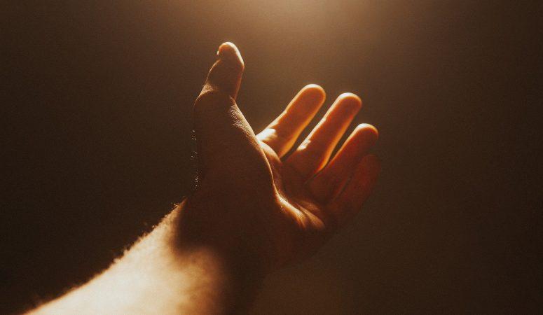 hand stretched upward